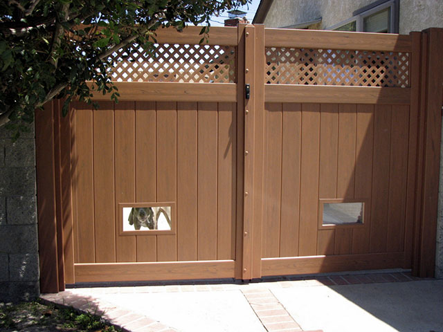 A very popular option for a single swing gate or double swing gate is the custom installation of dog doors and windows. & Dog Fencing Ideas - Dog Doors Windows | Vinyl Concepts pezcame.com